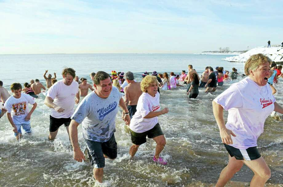 An estimated 200 participants — including Mayor Ed O'Brien, Westies T-shirt, and his son, David, red-and-white T-shirt — dash in and out of 41-degree water in Long Island Sound during the 16th annual Icy Plunge for the Cure benefit Feb. 6 at Savin Rock Beach. Photo: Contributed Photo — Michael P. Walsh