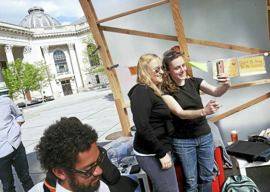 Melissa Etheridge, center, takes a selfie with Robin Canavan inside the encampment for fasting graduate teachers and members of Local 33 Unite Here at Yale University's Beinecke Plaza Tuesday. Canavan is one of eight fasting graduate teachers. Photo: Arnold Gold — New Haven Register