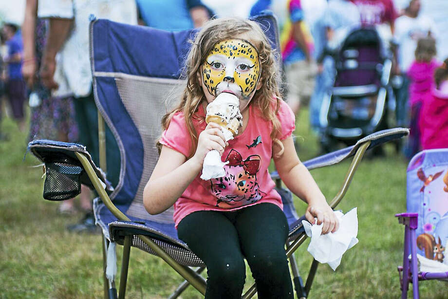 A young girl enjoys the face-painting and ice cream at last year's Soupstock. Photo: Contributed