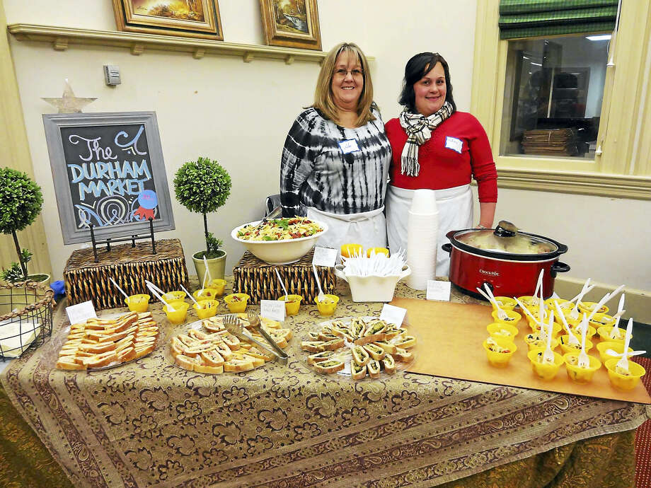 Kim Mounts, owner of Durham Market, and server Melanie Medore are seen at last year's Taste of Durham. Photo: CONTRIBUTED PHOTO — Durham Library