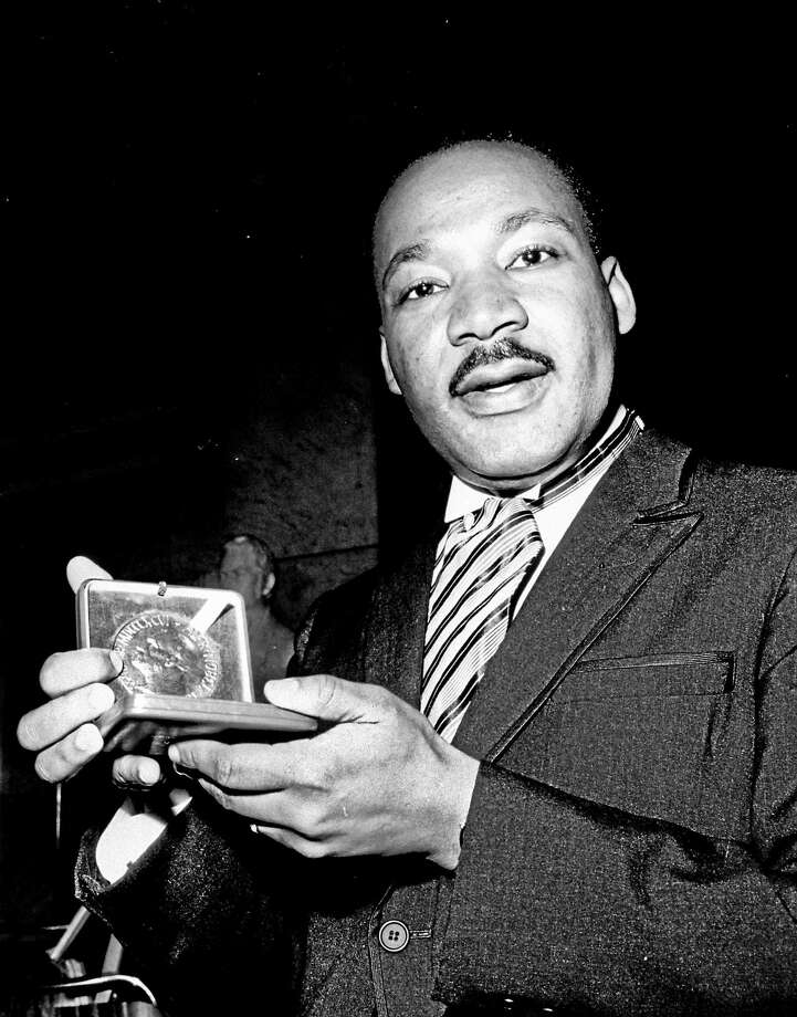 U.S. civil rights leader Dr. Martin Luther King, Jr. holds his 1964 Nobel Peace Prize medal in Oslo, Norway. Photo: AP File Photo / AP