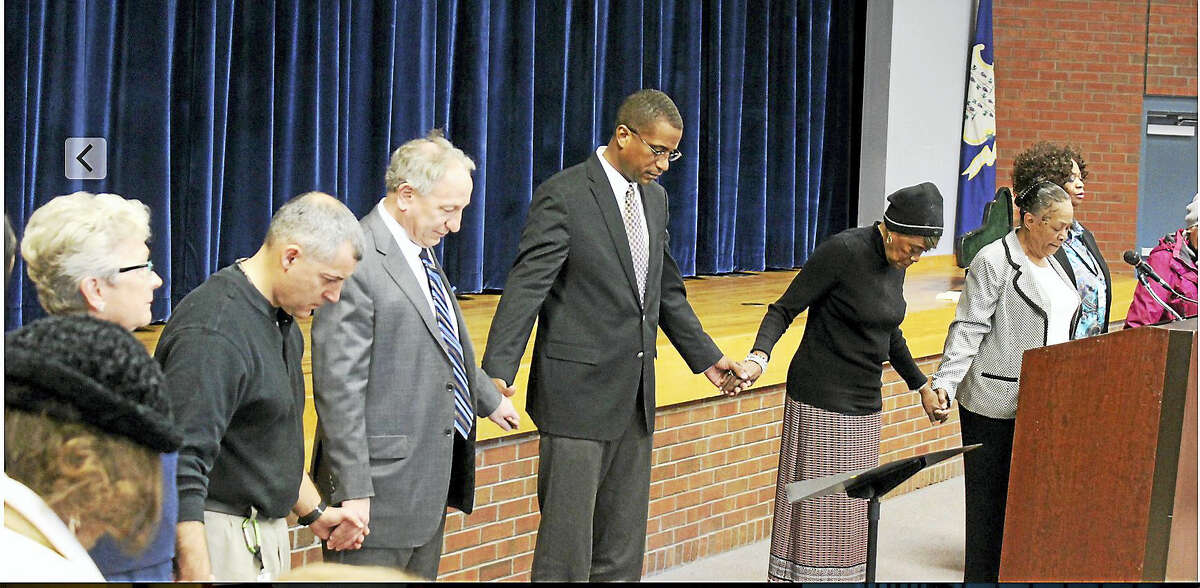 Hamden's annual Martin Luther King Day celebration ended Friday with a circle of prayer and song.