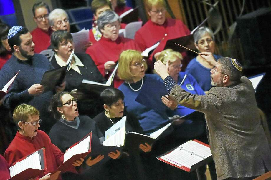 "The Combined Interfaith Choir performs ""This Little Light of Mine"" at the annual interfaith service in tribute to the Rev. Martin Luther King Jr. on Friday at Congregation Mishkan Israel in Hamden. Photo: Catherine Avalone — New Haven Register   / Catherine Avalone/New Haven Register"