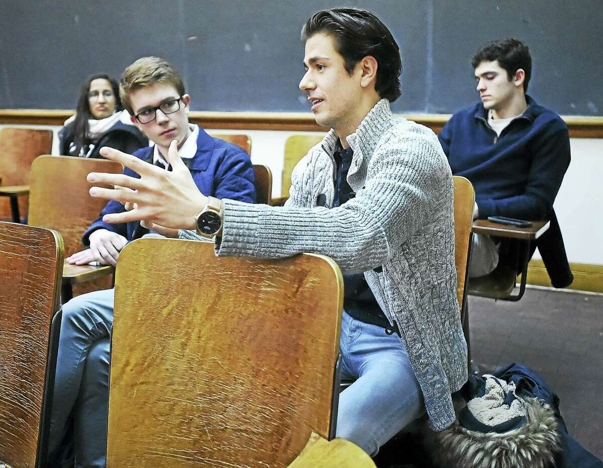 Yale senior Phil Wilkinson of New Mexico, a member of Yale College Democrats asks a question of former Vermont Gov. Howard Dean Wednesday at Yale University's William L. Harnkess Hall.