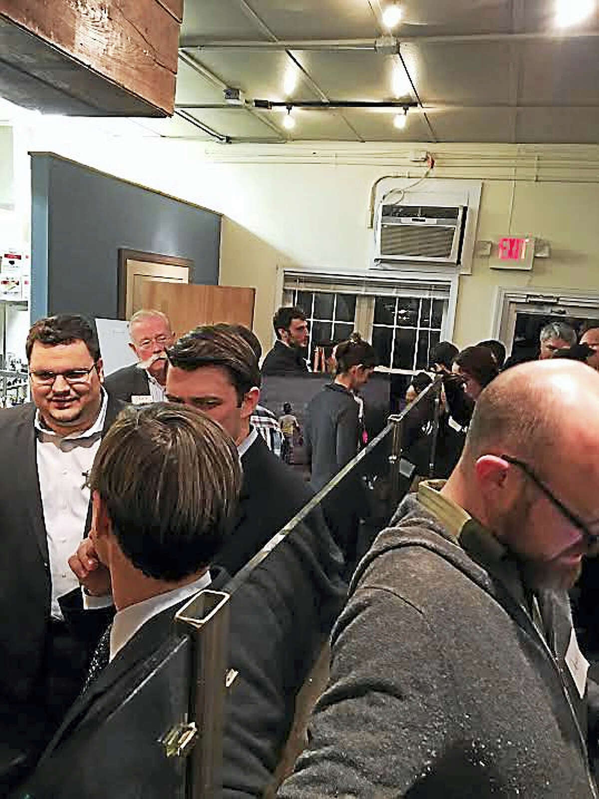 Well-wishers crammed into the City Point Kitchen Wednesday to celebrate a new partnership between Schooner Inc. and New Haven Land Trust.
