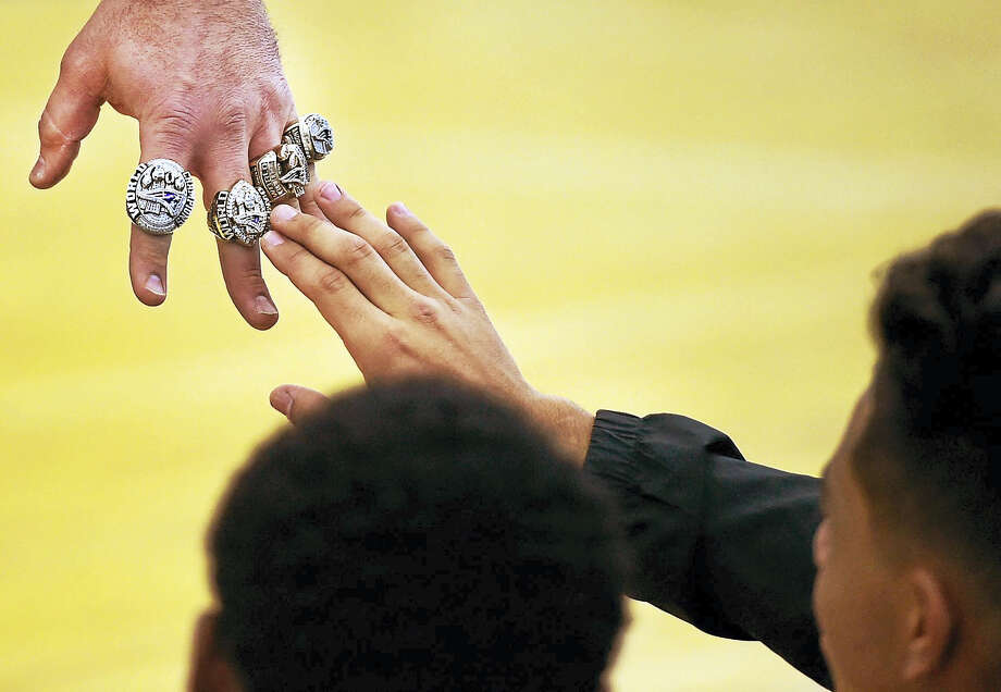 Former New England Patriots lineman and assistant coach Joe Andruzzi shows off his four Super Bowl rings to New Haven's high school football players and students during the Walter Camp Football Foundation Stay In School Rally at the Floyd Little Athletic Center in New Haven Thursday morning, Jan. 12, 2017. Photo: Peter Hvizdak — New Haven Register   / ?2017 Peter Hvizdak