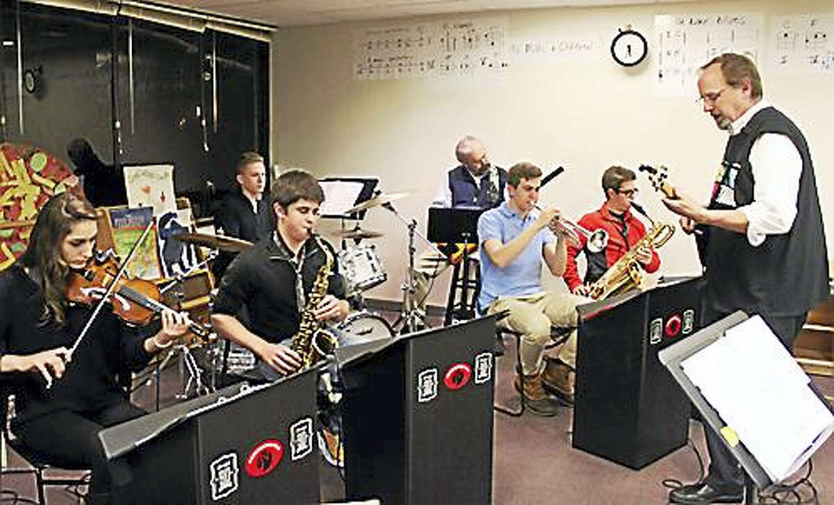 Members of the Neighborhood DoSo Dance Band at their weekly rehearsal.