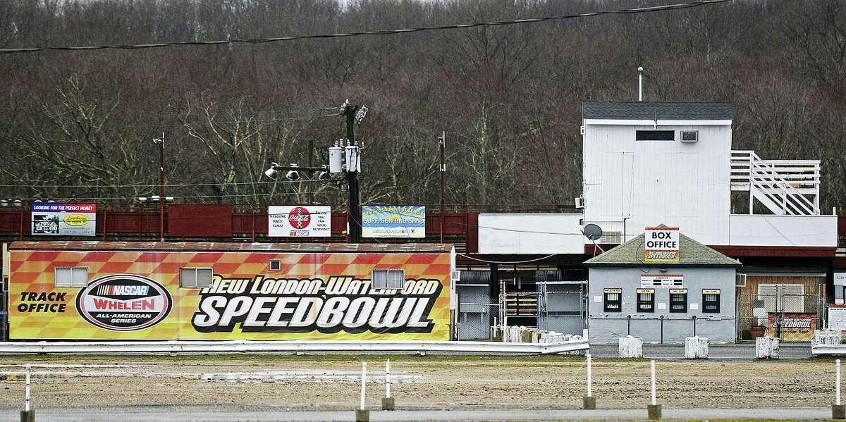 In this April 6, 2017 photo, the NASCAR logo is among the signs at the the ticket entrance of the New London Waterford Speedbowl in Waterford, Conn. The track, in operation since 1951, postponed its planned May 6 opening after NASCAR pulled its sanctions in April following the arrest of owner Bruce Bemer.