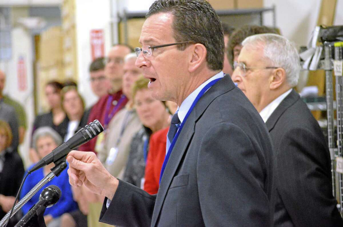 John Berry/Register Citizen. Governor Dannel P. Malloy speaks to the staff at Altek Electronics in Torringon on Wednesday as the tech manufacturer celebrates its 40th year.