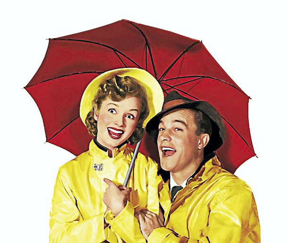 "Debbie Reynolds and Gene Kelly in ""Singin' in the Rain."" Photo: Contributed"