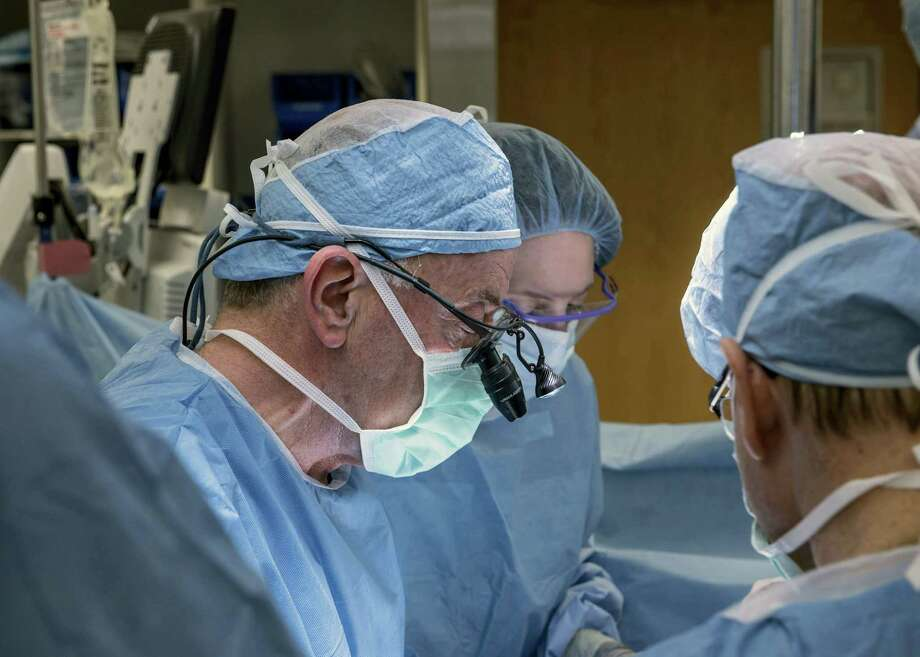 Cleveland Clinic Center via AP  In this Feb. 24, 2016, photo, a team of Cleveland Clinic transplant surgeons and gynecological surgeons perform the nation's first uterus transplant during a nine-hour surgery in Cleveland. Photo: AP / Cleveland Clinic Center