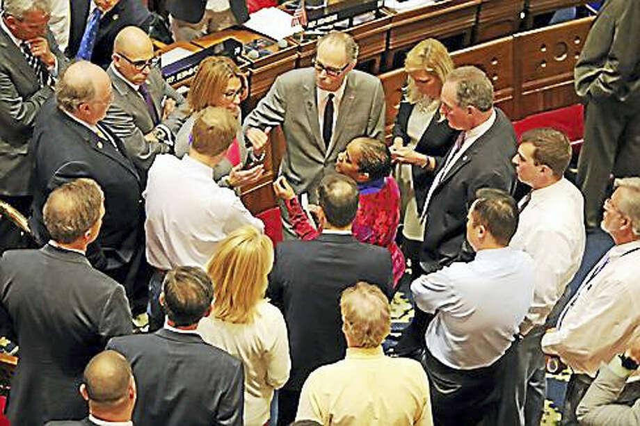 Connecticut House members debate a point of parliamentary inquiry. Photo: Christine Stuart — Ctnewsjunkie