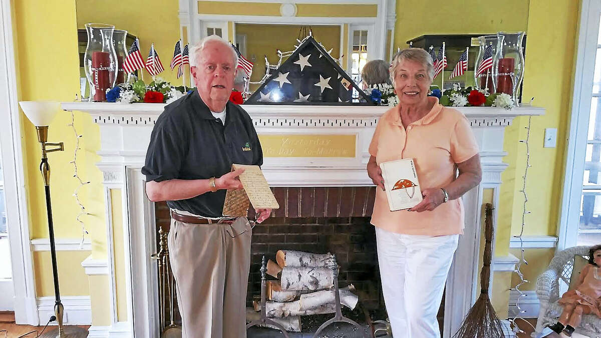 West Haven Historical Society President Jon Purmont, left, and Lois Doerr with a diary and a book on loan from the Treat family that are part of the World War I exhibit that will be on display at the Historical Society during its Open House Saturday and Sunday from 11 a.m. to 4 p.m.