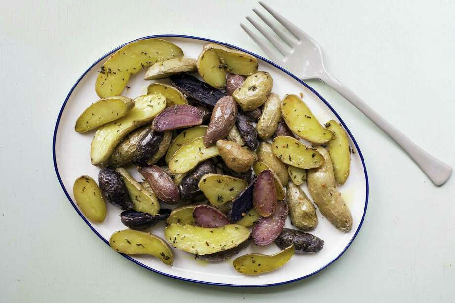 Herb-roasted fingerling potatoes. Photo: Sarah E. Crowder Via AP   / Katie Workman