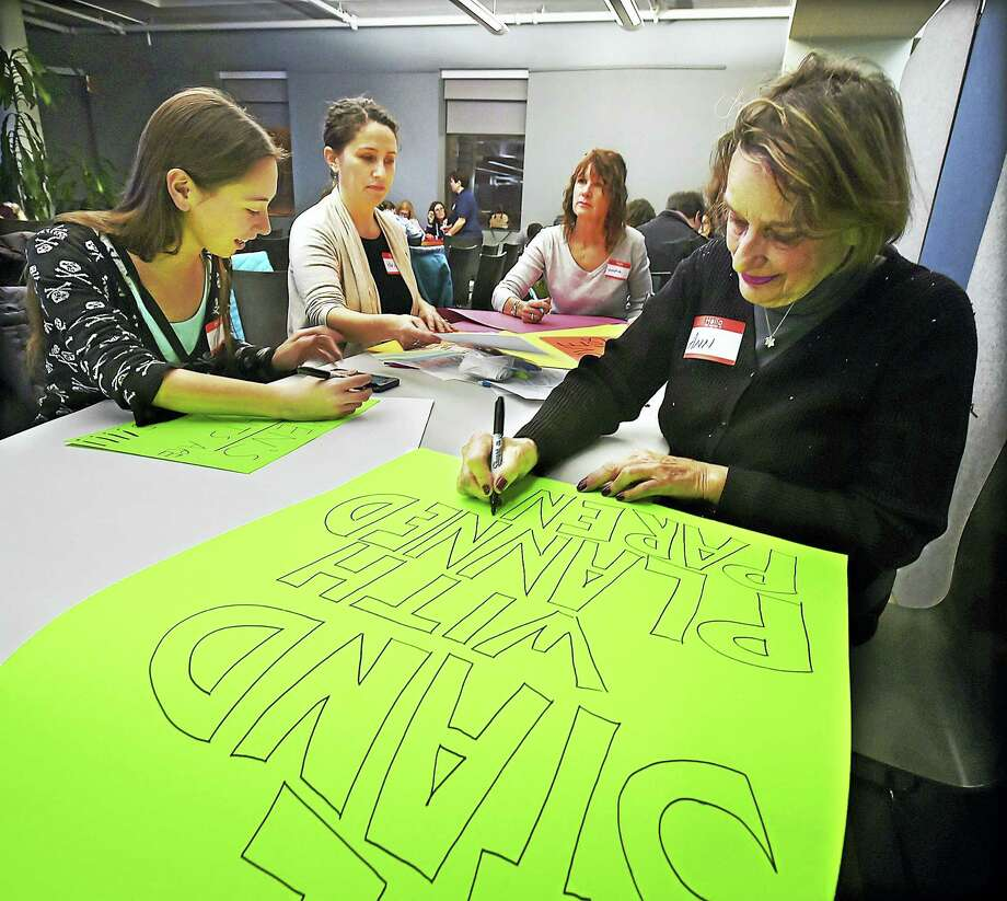 Milford resident Ann Carter, right, and members of the Connecticut chapter of the National Organization for Women attend a meeting at the New Haven Free Public Library Thursday preparing for the Women's March on Washington Jan. 21. Photo: Catherine Avalone — New Haven Register    / Catherine Avalone/New Haven Register