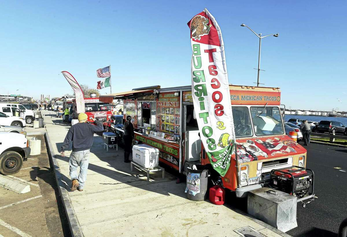 Food trucks line Long Wharf Drive during lunchtime in New Haven in November 2016.