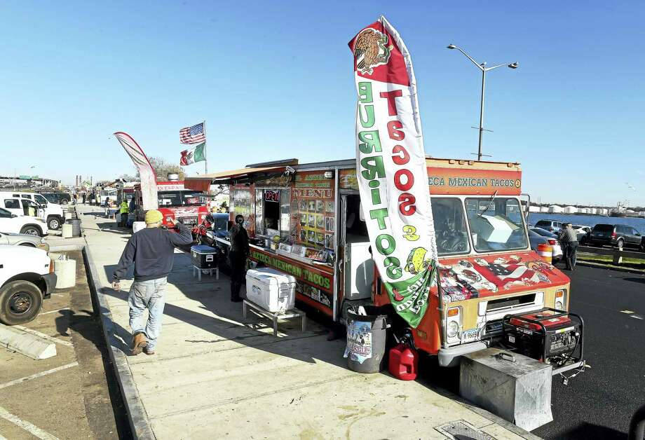 Food trucks line Long Wharf Drive during lunchtime in New Haven in November 2016. Photo: Arnold Gold — New Haven Register File Photo