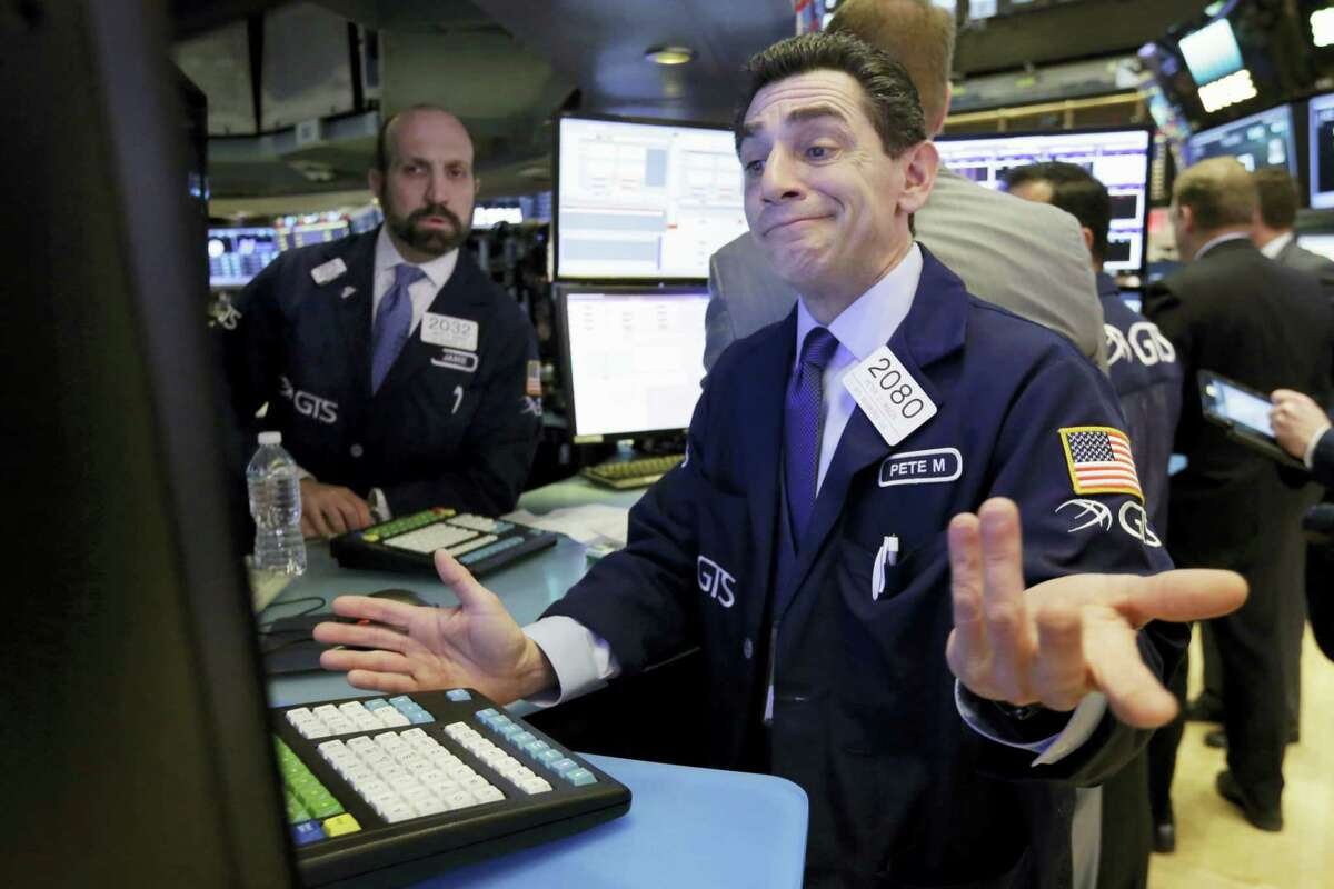Specialist Peter Mazza works at his post on the floor of the New York Stock Exchange, Thursday. U.S. stocks moved broadly lower in early trading Thursday, giving back the market's gains from the day before.
