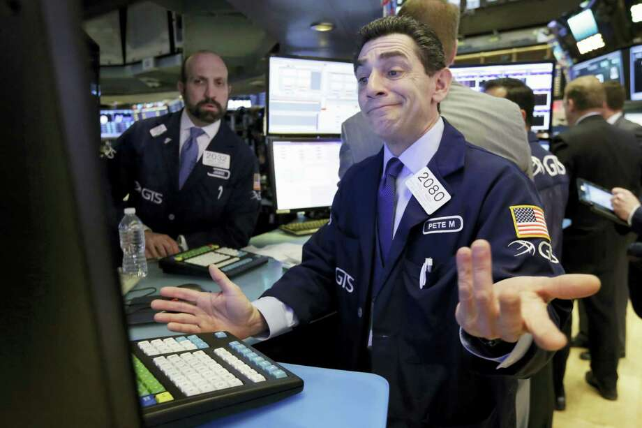 Specialist Peter Mazza works at his post on the floor of the New York Stock Exchange, Thursday. U.S. stocks moved broadly lower in early trading Thursday, giving back the market's gains from the day before. Photo: Richard Drew — The Associated Press   / AP