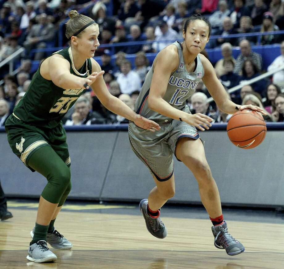 Connecticut's Saniya Chong, right, dribbles around South Florida's Kitija Laksa in the Huskies win on Tuesday. Photo: Jessica Hill — The Associated Press   / AP2017