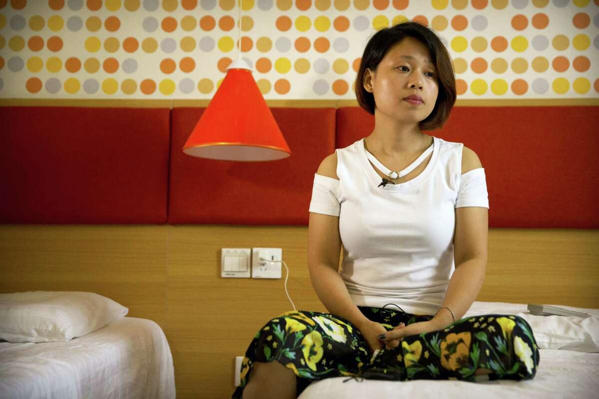 Deng Guilian, the wife of detained Chinese labor activist Hua Haifeng, speaks during an interview in Ganzhou in southeastern China's Jiangxi Province, Tuesday, June 6, 2017. The Chinese government rejected calls to release three activists detained while investigating a Chinese company that produced shoes for Ivanka Trump and other brands and sought to enforce a cone of silence around the men, according to a family member and lawyer who were interrogated and told not to speak to the foreign press.