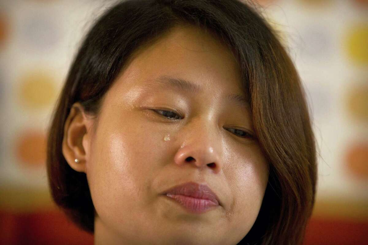Deng Guilian, the wife of detained Chinese labor activist Hua Haifeng, sheds a tear during an interview in Ganzhou in southeastern China's Jiangxi Province, Tuesday, June 6, 2017. The Chinese government rejected calls to release three activists detained while investigating a Chinese company that produced shoes for Ivanka Trump and other brands and sought to enforce a cone of silence around the men, according to a family member and lawyer who were interrogated and told not to speak to the foreign press.