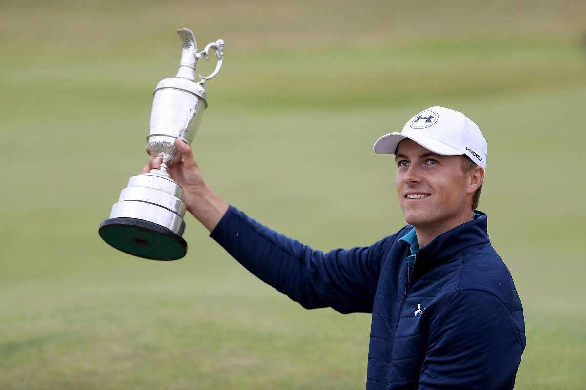 SOUTHPORT, ENGLAND - JULY 23: Jordan Spieth of the United States celebrates victory as he poses with the Claret Jug on the 18th green during the final round of the 146th Open Championship at Royal Birkdale on July 23, 2017 in Southport, England. (Photo by Christian Petersen/Getty Images)