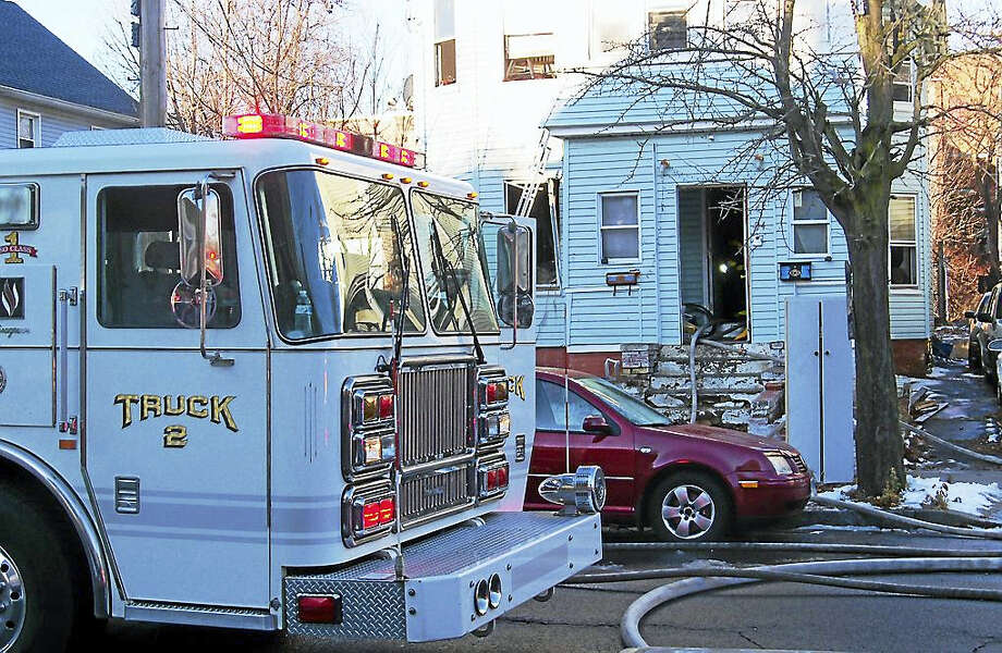 City firefighters quickly knocked down a fire Wednesday morning in a home at 94 Plymouth St. There were no reported injuries. Photo: Wes Duplantier — New Haven Register