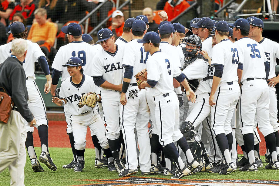 Yale Sports Publicity  Members of the Yale baseball team celebrate a run scoring in a victory over Holy Cross on Sunday. Photo: Digital First Media / ©2017 Steve Dipaola