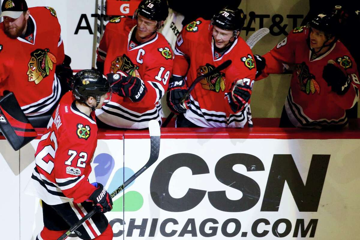Chicago Blackhawks left wing Artemi Panarin (72) celebrates with teammates after scoring a goal during the first period of an NHL hockey game against the Nashville Predators on Jan. 8, 2017 in Chicago.
