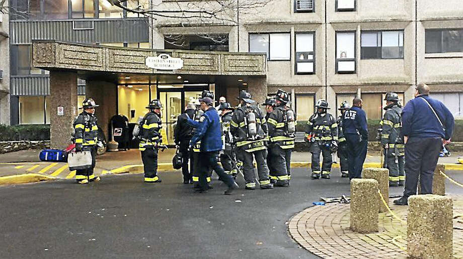 Firefighters on scene at the Bella Vista apartments to battle a small trash fire on Wednesday. Photo: Wes Duplantier — New Haven Register