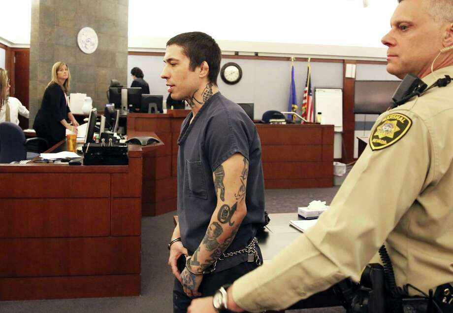 Former mixed martial arts fighter Jonathan Koppenhaver, aka War Machine, is led out of the courtroom at the Regional Justice Center on Monday in Las Vegas. Photo: Bizuayehu Tesfaye — Las Vegas Review-Journal Via AP   / Las Vegas Review-Journal