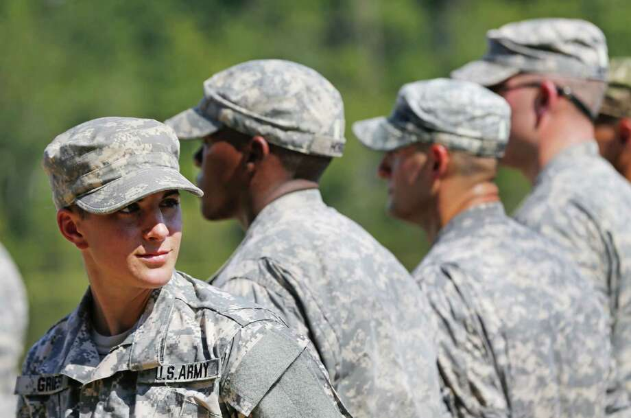U.S. Army Capt. Kristen Griest, of Orange, left, smiles as she stands in formation during an Army Ranger School graduation ceremony at Fort Benning, Ga. Photo: John Bazemore — The Associated Press   / AP