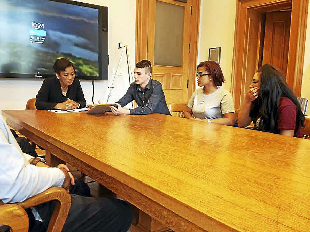 High School in the Community students Sean Nelson, Jasalay Mercado and Jenna McKechnie meet with Mayor Toni Harp to discuss their service trip to Nicaragua.