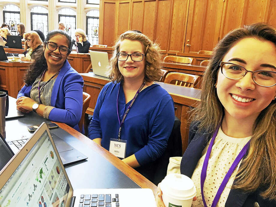 From left, Yale students Ottvia Muralteetharan, Ariel Murphy and Valentina Guerrero attend the Women's Campaign School Monday. Photo: Mary O'Leary — New Haven Register