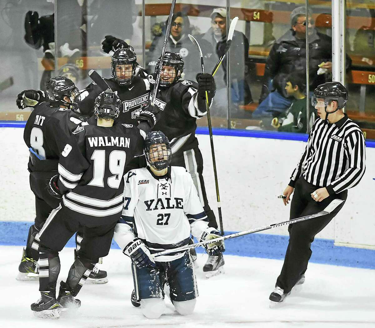 Providence left wing Josh Wilkins (15) celebrates after scoring in the second period after the puck is deflected off Yale forward Luke Stevens (27) in a 3-1 win over the Bulldogs at the Ingalls Rink.