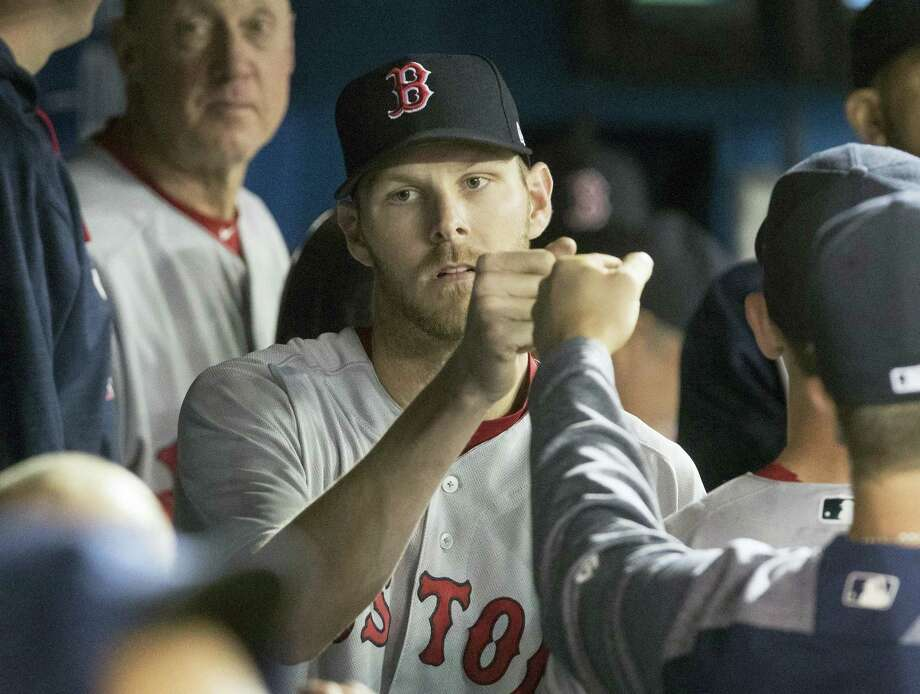Boston Red Sox starting pitcher Chris Sale is congratulated in dugout during the eighth inning of a baseball game against the Toronto Blue Jays in Toronto on April 20, 2017. Photo: Fred Thornhill — The Canadian Press Via AP   / The Canadian Press