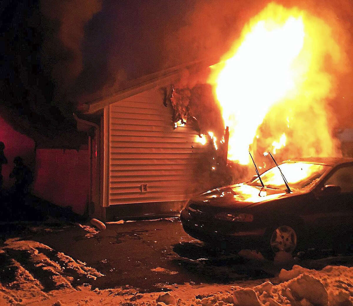 Hamden firefighters battled a garage fire Monday night at 6 Wilson Lane, just off Benham Street. The flames were contained to the garage but the home sustained heat and smoke damage.