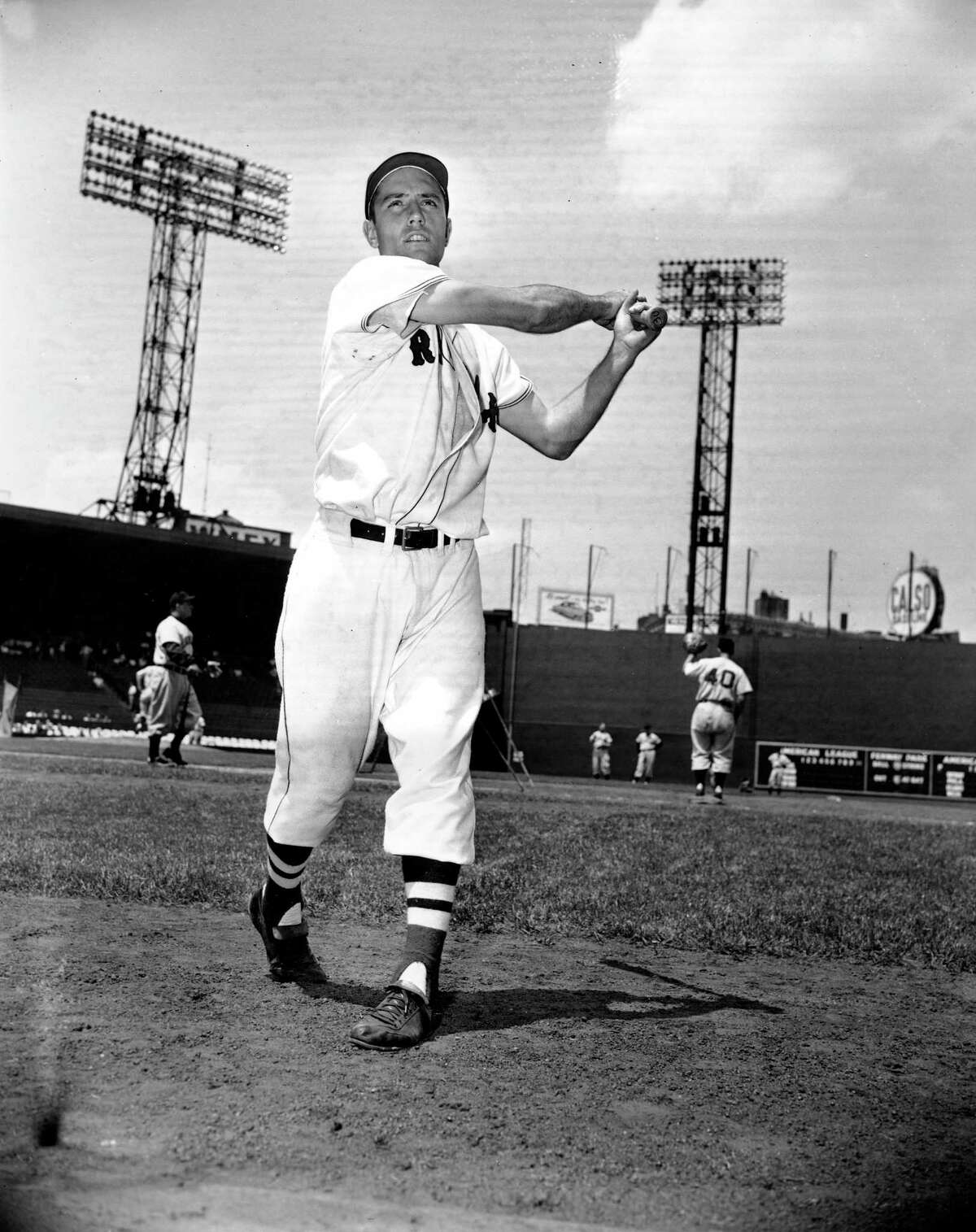 In this June 4, 1952 photo, Jim Piersall of the Boston Red Sox poses at Fenway Park in Boston, Ma., before a game against the Cleveland Indians. Piersall, who bared his soul about his struggles with mental illness in his book 'Fear Strikes Out,' has died. The Boston Red Sox, for whom Piersall played for seven of his 17 seasons in the majors, said Piersall died Saturday, June 3, 2017 at a care facility in Wheaton, Ill. after a monthslong illness.