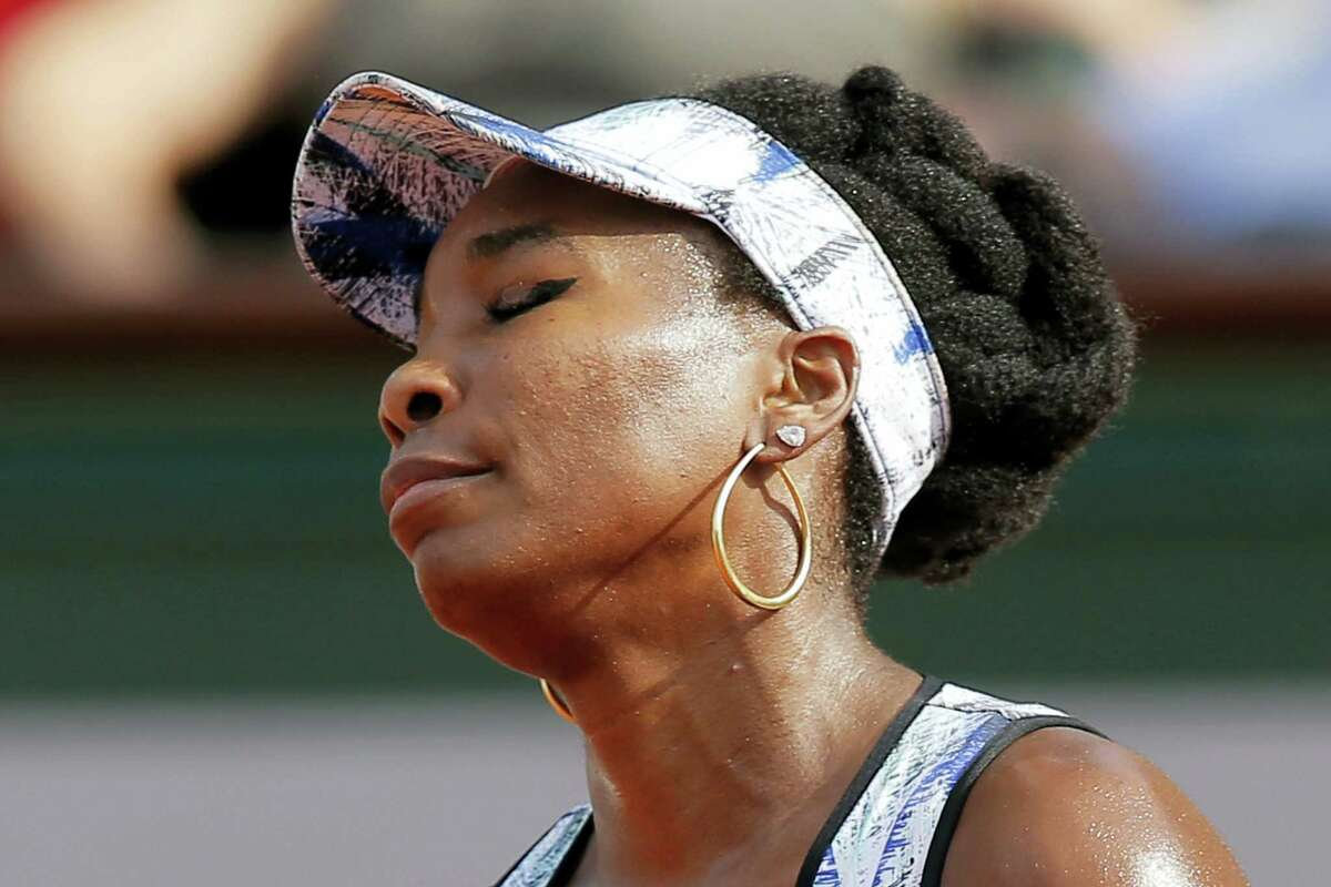 Venus Williams of the U.S. closes her eyes after missing a shot against Timea Bacsinszky of Switzerland during their fourth round match of the French Open tennis tournament at the Roland Garros stadium, in Paris, France on Sunday, June 4, 2017.