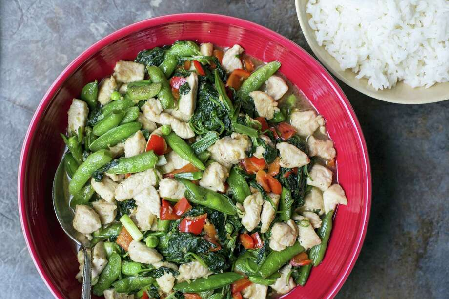 Chicken and vegetable stir-fry is light but satisfying, perfect for a cold, January night. Photo: Sarah Crowder — The Associated Press   / Sarah Crowder