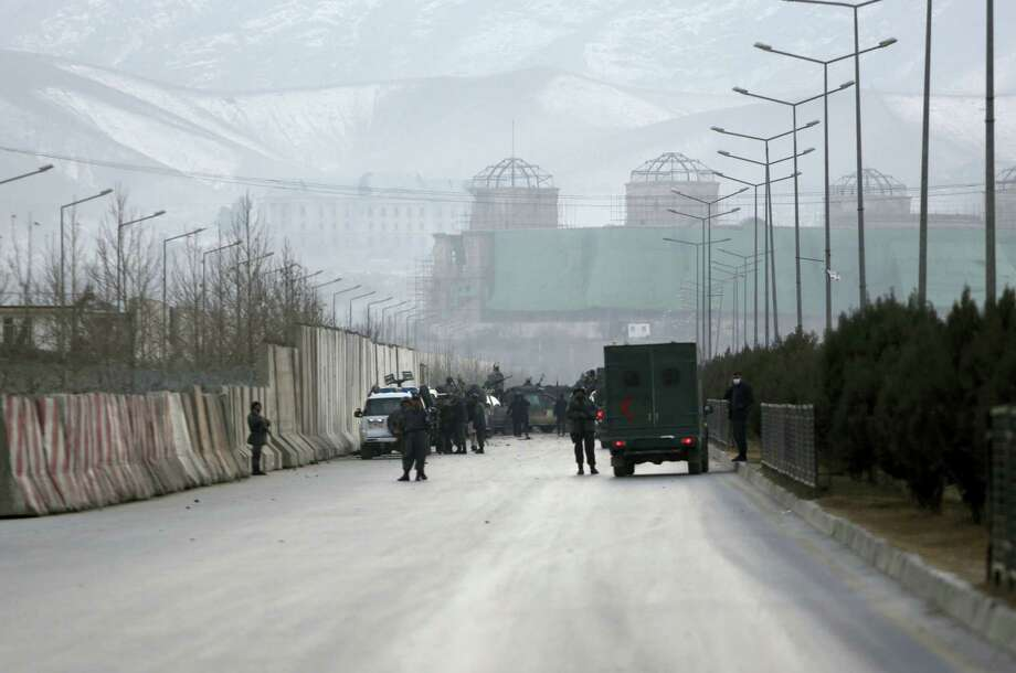 Afghan security forces inspect the site of two large bombings in Kabul, Afghanistan, Tuesday, Jan. 10, 2017. Two loud explosions have rocked the Afghan capital of Kabul, causing casualties. The target of the blasts was probably an area that includes government and lawmakers' offices. Sediq Sediqqi, spokesman for the Interior Ministry, said that first, a suicide bomber carried out an attack, followed by a second explosion, caused by car bomb parked near the site. Photo: Rahmat Gul — AP Photo / Copyright 2017 The Associated Press. All rights reserved.