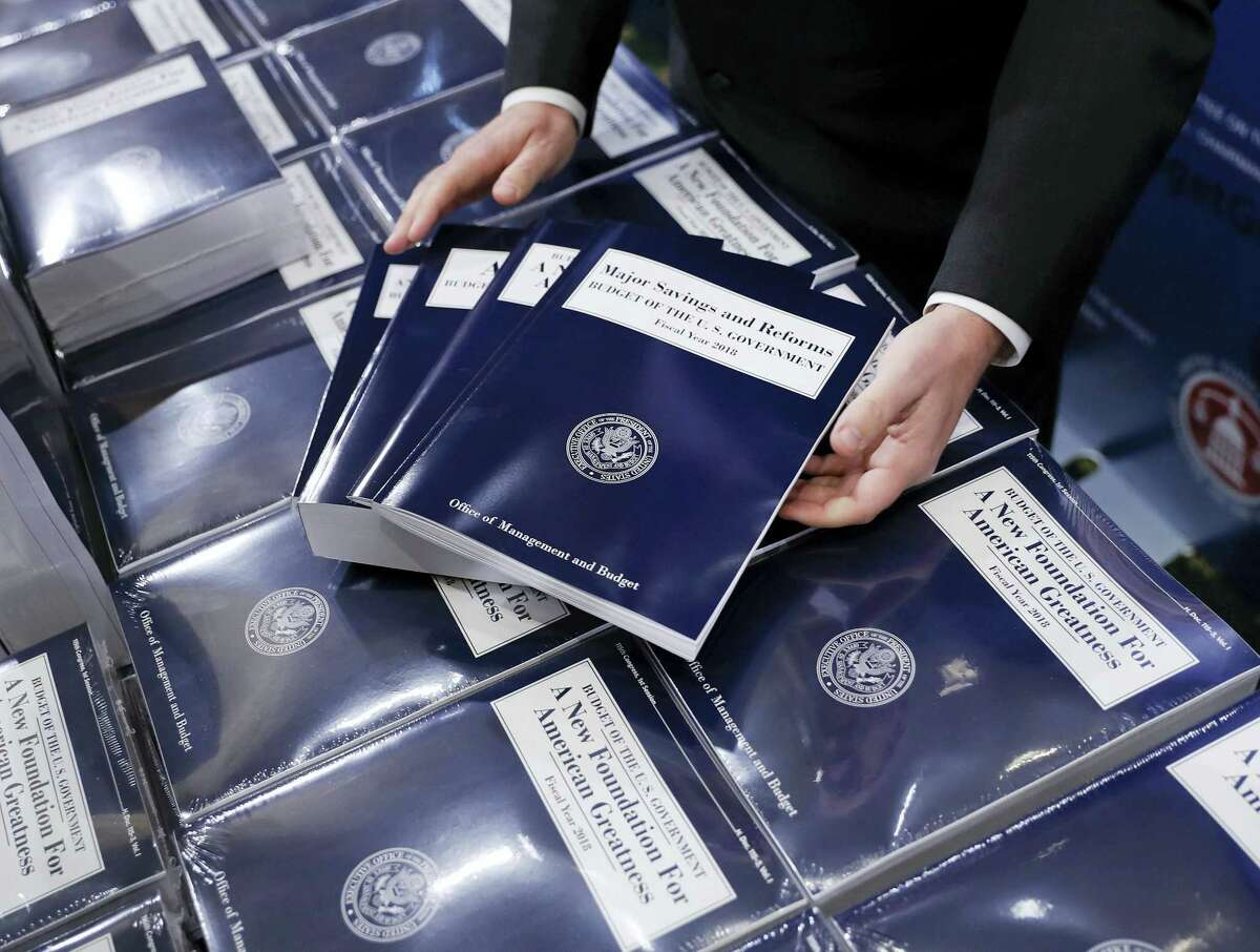 In this May 23, 2017 photo, copies of President Donald Trump's fiscal 2018 federal budget are seen on Capitol Hill in Washington. Congress faces a burst of overdue budget-related work this summer, most of which probably won't bear much resemblance to Trump's budget, which promised deep spending cuts on domestic programs, rapid economic growth, and a balanced federal ledger in a decade.