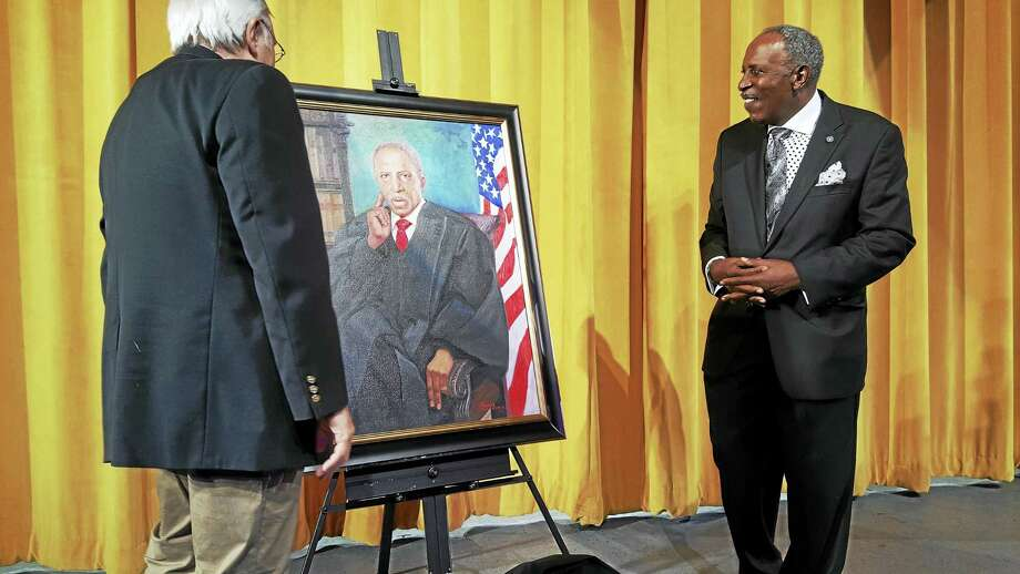 Photo by Shahid Abdul-Karim   Supreme Court Justice Lubbie Harper Jr., right, is honored recently at the University of New Haven with a scholarship endowment and a portrait by Franco Accornero, left. Photo: Digital First Media