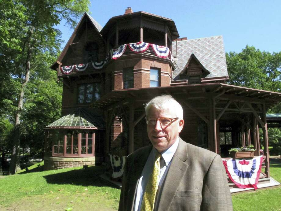 In this Thursday, June 1, 2017 photo, Pieter Roos, the new executive director of the Mark Twain House & Museum, poses outside the landmark in Hartford, Conn. Roos starts his new job July 5 after 18 years as executive director of Newport Restoration Foundation in Rhode Island. (AP Photo/Dave Collins) Photo: AP / Copyright 2017 The Associated Press. All rights reserved.