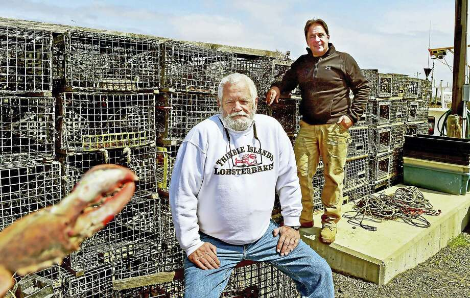 Mike McCleery, owner of Thimble Islands Lobsterbakes of Branford, left, with his lobster supplier Bart Mansi, lobsterman and co-owner of  the Guilford Lobster Pound in Guilford at the Lobster Pound dock. Photo: Peter Hvizdak - New Haven Register   / ?2017 Peter Hvizdak
