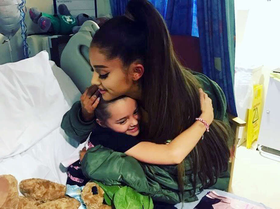 In this photo taken June 2, 2017 provided by the Manchester Evening News, victim of the Manchester concert blast Lily Harrison hugs singer Ariana Grande during her visit to the Royal Manchester Children's Hospital, in Manchester, England. Grande surprised young fans injured in the Manchester Arena attack, hugging the thrilled little girls in their hospital beds as they recovered from injuries sustained in the May 22 suicide bombing. Photo: Manchester Evening News Via AP   / Family