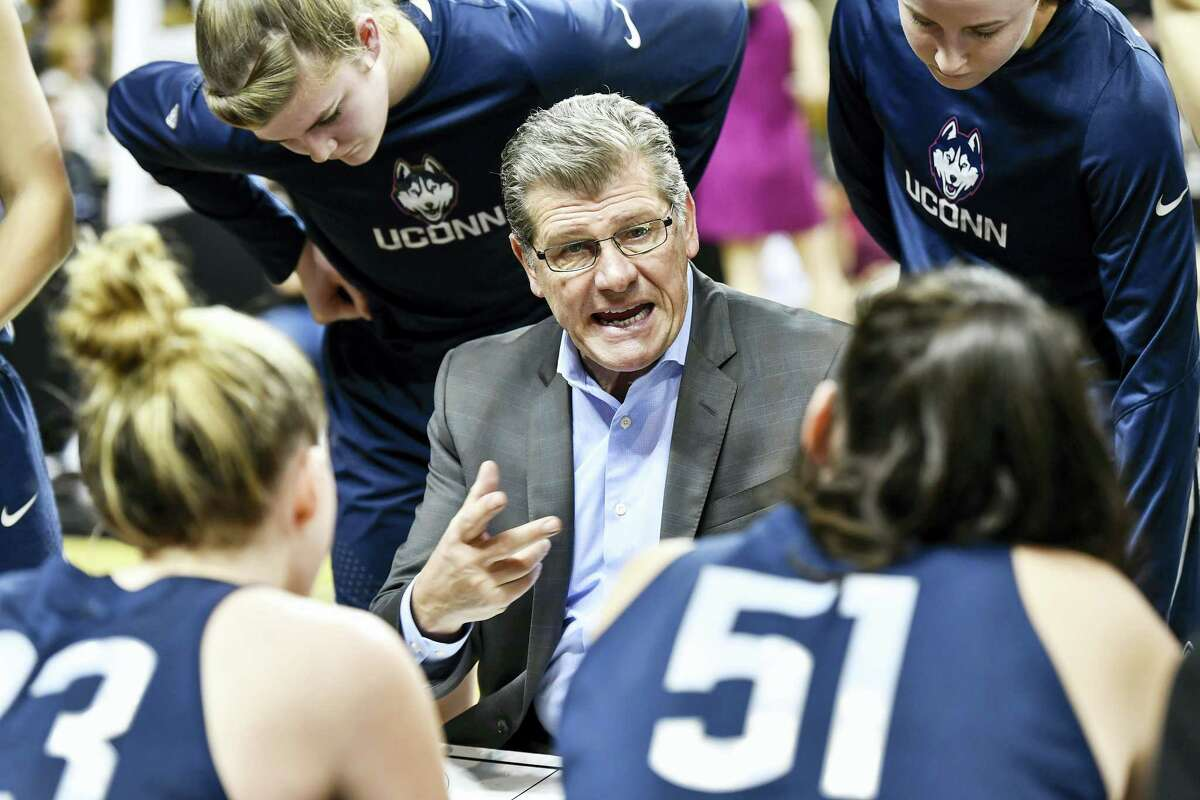 UConn coach Geno Auriemma gives instruction to his team during a recent game.