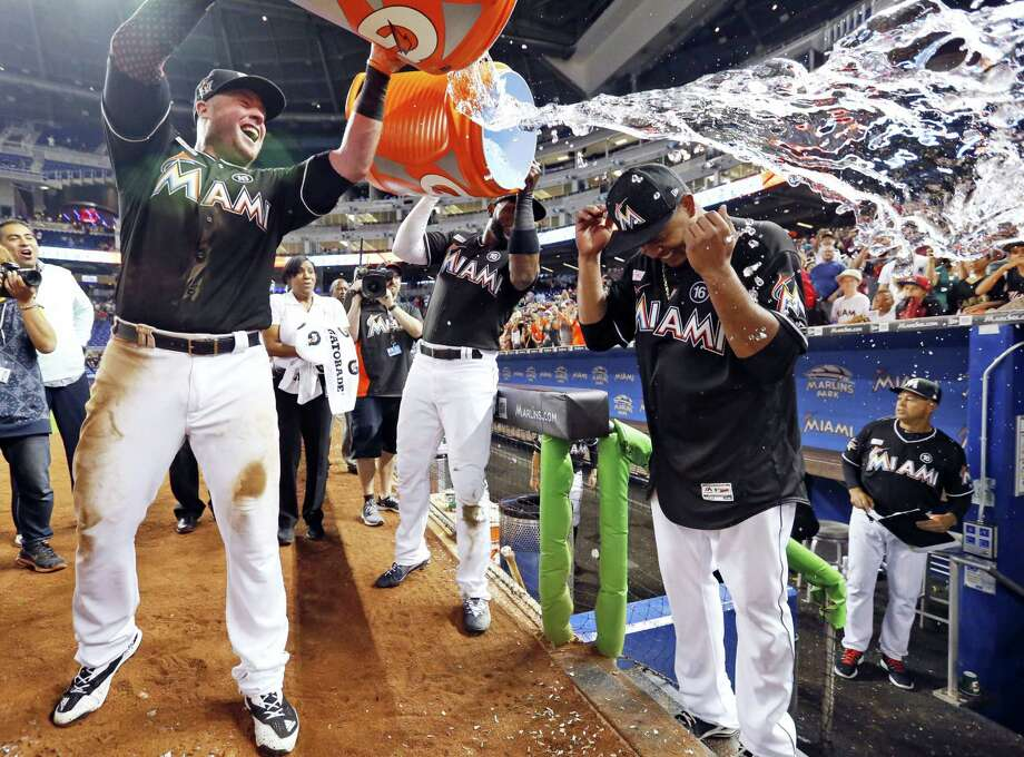 Miami Marlins' Justin Bour, left, and Marcell Ozuna, center rear, pour ice and water onto starting pitcher Edinson Volquez, right, after the Marlins defeated the Arizona Diamondbacks 3-0 in a no-hitter by Volquez Saturday in Miami. Photo: Wilfredo Lee — The Associated Press   / Copyright 2017 The Associated Press. All rights reserved.