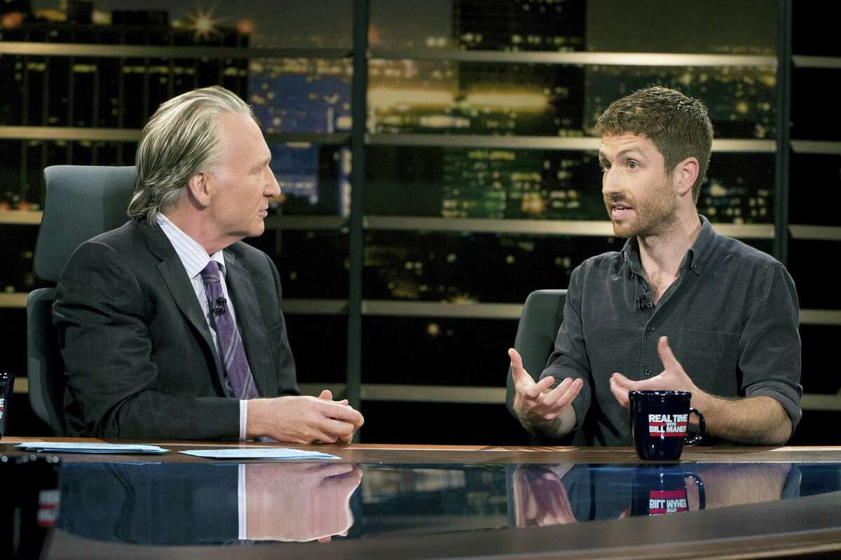 "In this photo provided by HBO, Bill Maher, left, speaks with Sen. Ben Sasse of Nebraska during a segment of his ""Real Time with Bill Maher,"" Friday, June 2, 2017. Maher is facing criticism for his use of a racial slur during a discussion with the Republican senator on his HBO talk show Friday night."